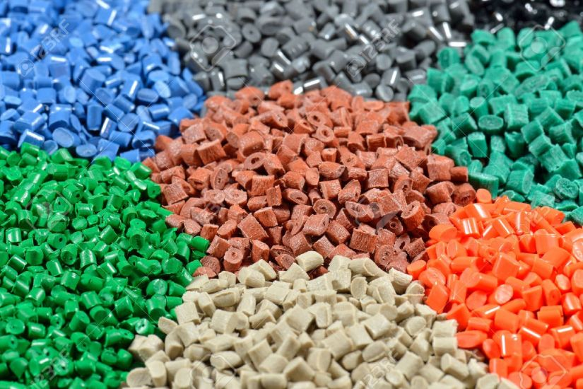 24421493-several-dyed-polymer-pellets-for-plastic-industry-stock-photo